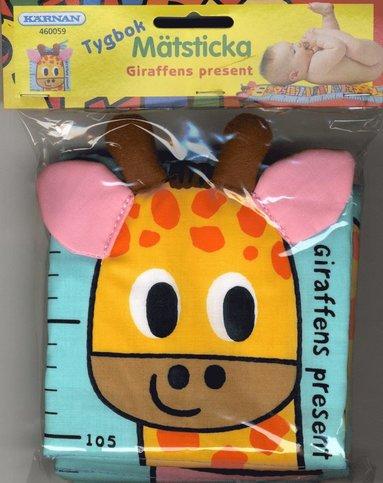 bokomslag Tygbok - Giraffen present Mätsticka