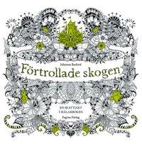 bokomslag Förtrollade skogen - en målarbok