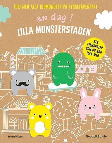 bokomslag En dag i Lilla monsterstaden : följ med alla rismonster på pysseläventyr!