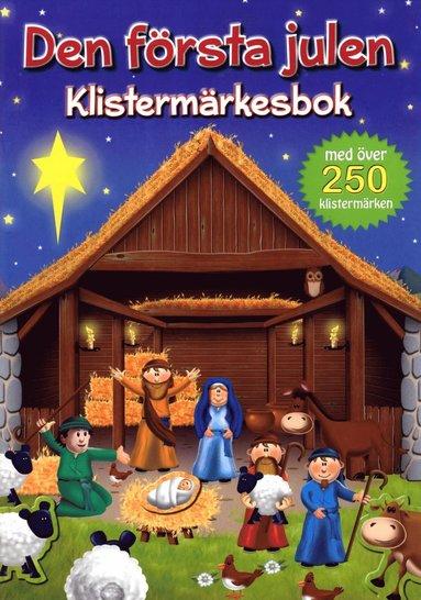 bokomslag Den första julen - Klistermärkesbok