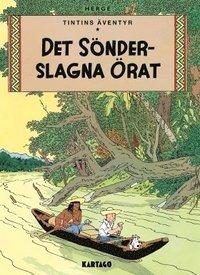 bokomslag Tintins äventyr. Det sönderslagna örat